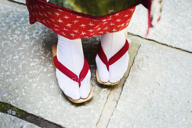 Geisha feet in wooden soled sandals — Stock Photo