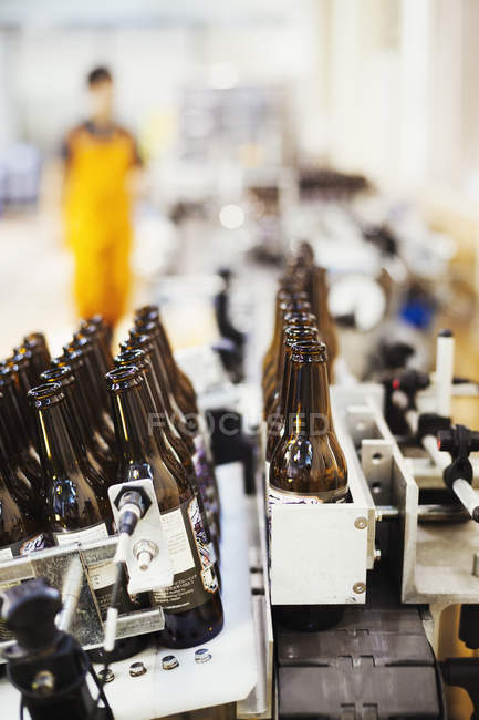 Bottle filling machine in a brewery. — Stock Photo