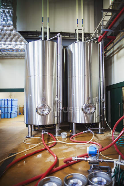 Metal beer tanks in a brewery — Stock Photo