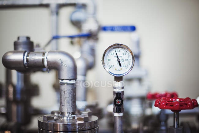 Machinery and gauge in a brewery. — Stock Photo