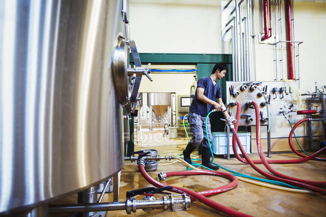 Man working in a brewery — Stock Photo