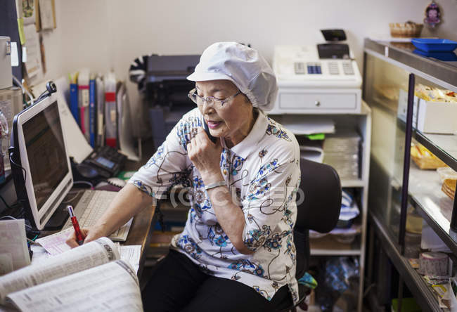 Woman in office of noodle production factory — Stock Photo