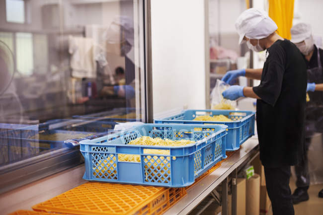 Workers in a soba noodle production unit. — Stock Photo