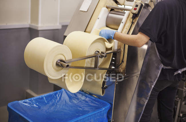 Worker in a factory producing Soba noodles — Stock Photo