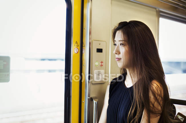 Woman  traveling on public transport — Stock Photo