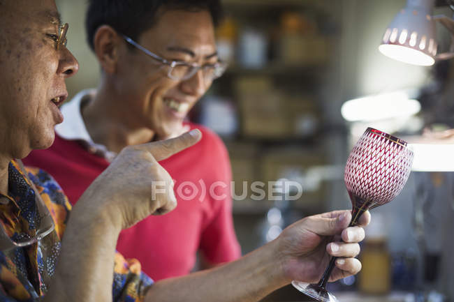 People in glass maker's studio workshop — Stock Photo