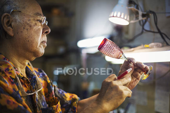 Senior craftsman at work — Stock Photo
