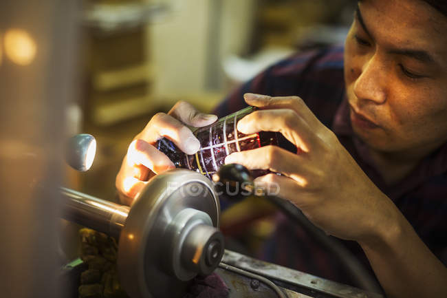 Craftsman at work at a machine — Stock Photo