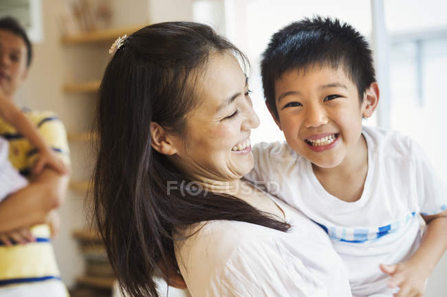 Mother holding her son — Stock Photo