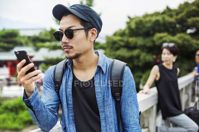 Man looking at his smart phone — Stock Photo