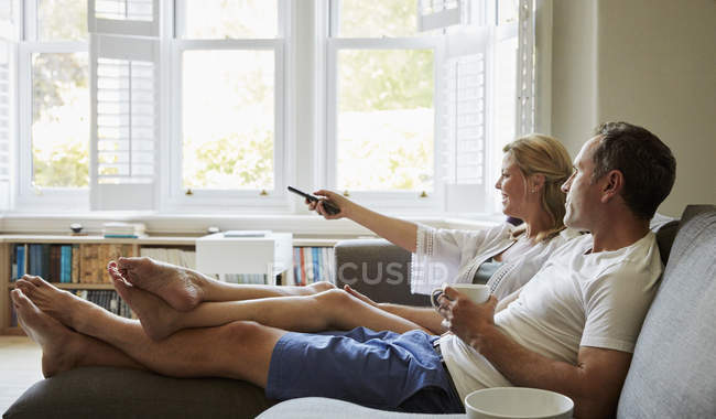 Couple, man and woman sitting on the sofa — Stock Photo