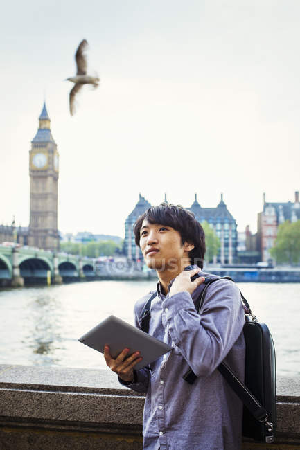 Japanese man by River Thames. — Stock Photo
