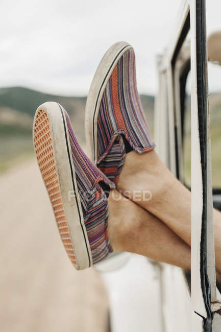 Feet sticking out of jeep — Stock Photo