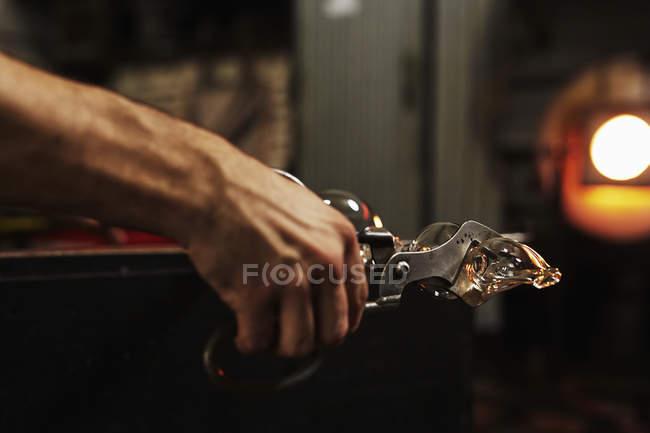 Man holding blown glass object — Stock Photo