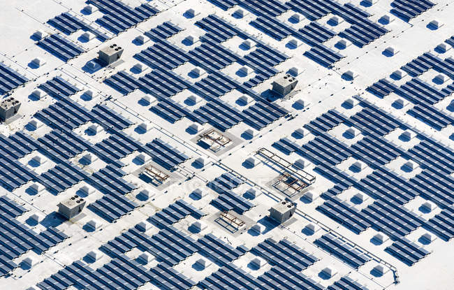 Blue solar panels in grid — Stock Photo