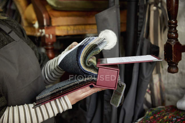 Woman flicking through fabric — Stock Photo