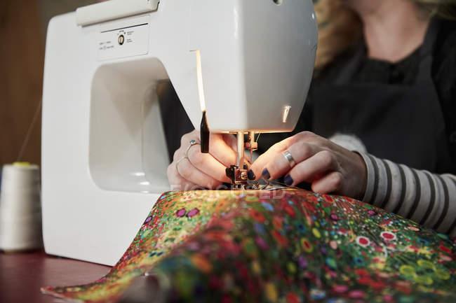 Woman permeates thread in needle — Stock Photo
