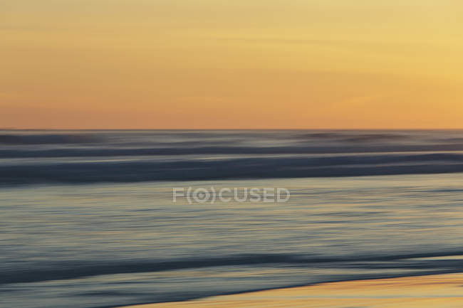 Ocean at sunset, long exposure — Stock Photo