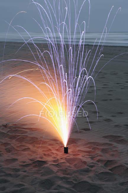 Firework on sand on Beach — Stock Photo