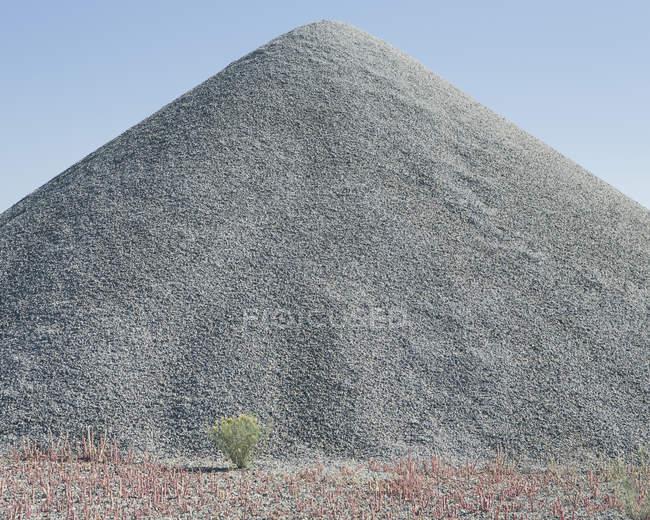Gravel pile in desert — Stock Photo