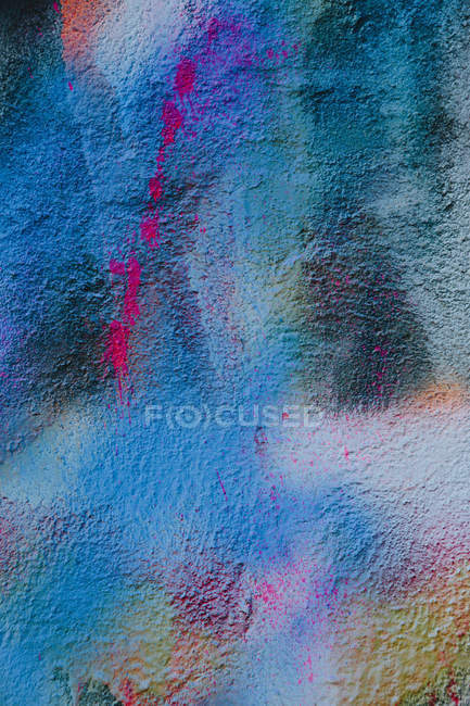 Wall daubed with colourful paint — Stock Photo