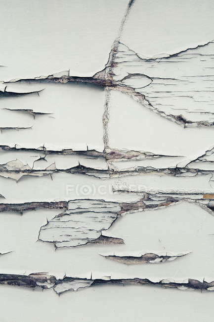 Cracked paint on wall — Stock Photo