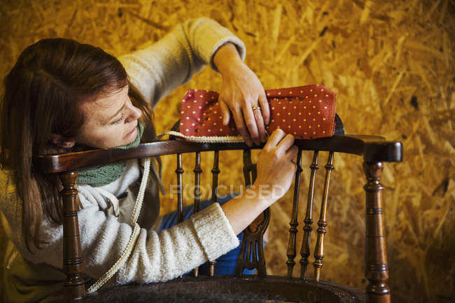 Woman working and repairing chair — Stock Photo