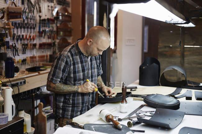 Craftsman at leather workshop — Stock Photo