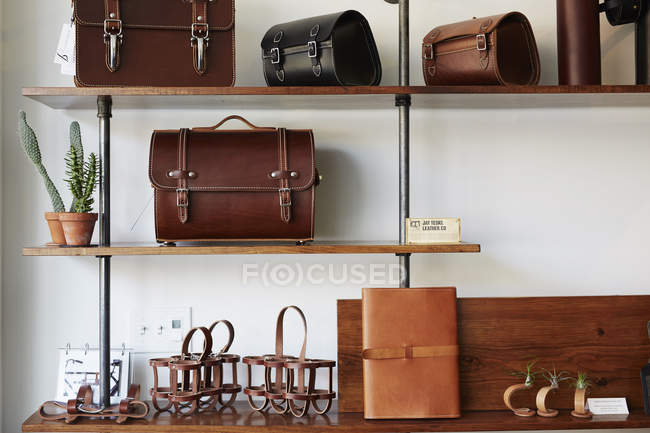 Briefcases and bags on shelves. — Stock Photo