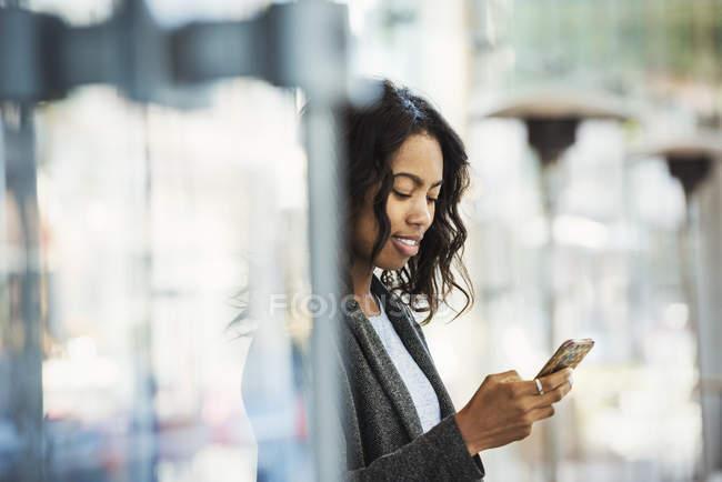 Woman checking mobile phone — Stock Photo