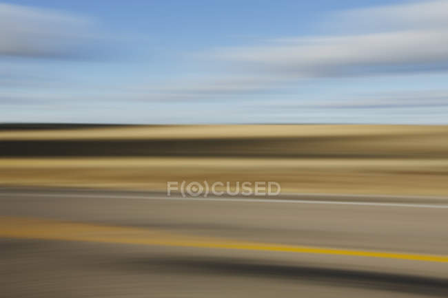 Blurred road and sky — Stock Photo