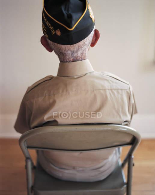 Seated elderly WWII veteran — Stock Photo