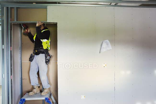 Carpenter using electric drill. — Stock Photo