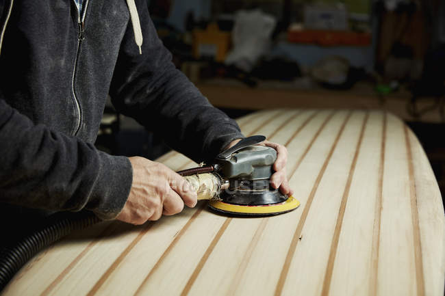 Man with electrical sander. — Stock Photo