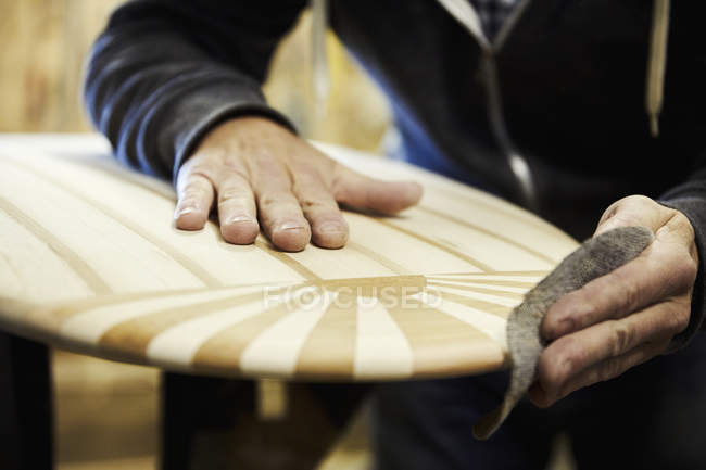 Man in surfboard workshop — Stock Photo