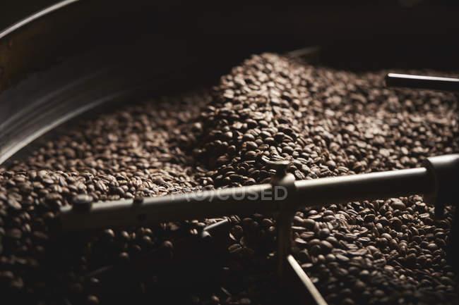 Drum of roasting coffee beans — Stock Photo