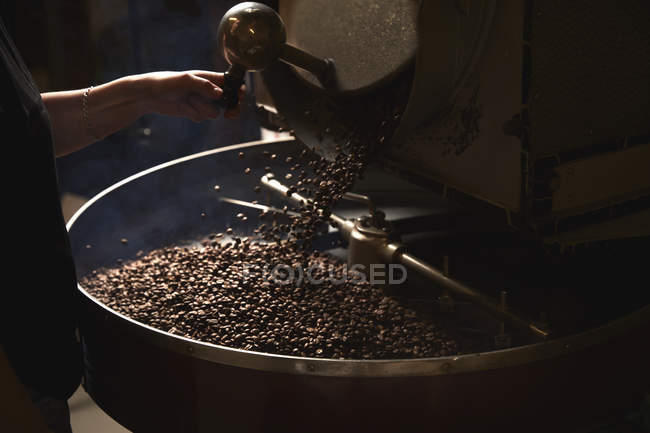 Metal drum with roasting coffee beans — Stock Photo