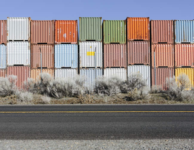 Stacks of colorful shipping containers — Stock Photo