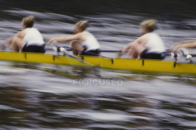Crew racers rowing scull boat — Stock Photo