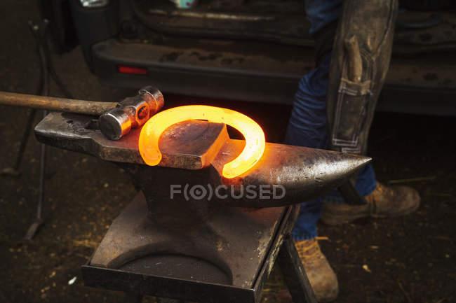 Red glowing heated metal horseshoe — Stock Photo