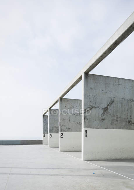 Numbered concrete pillars in handball court — Stock Photo