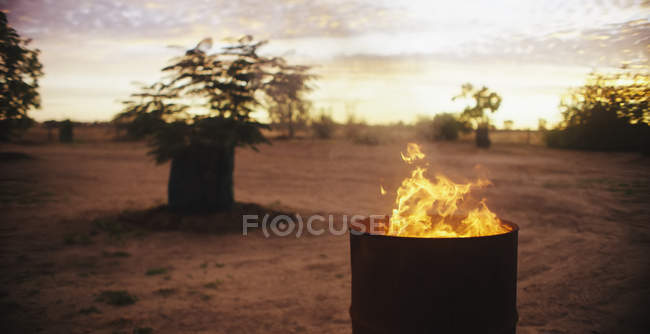 Fire burning in barrel — Stock Photo