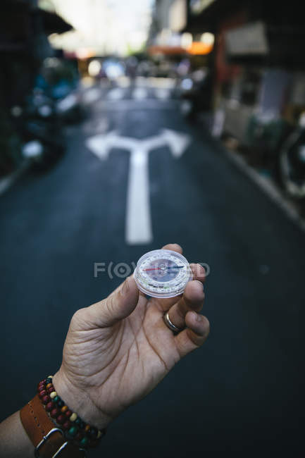 Male hand holding compass — Stock Photo