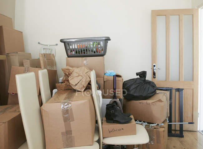 Room filled with cardboard boxes — Stock Photo