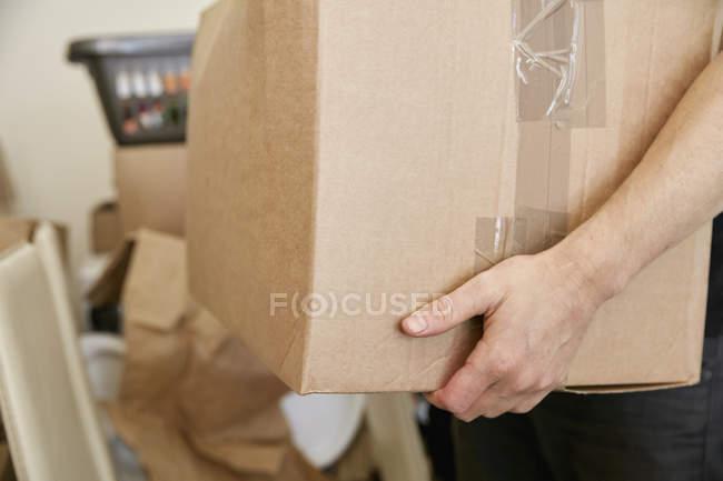 Man carrying cardboard box — Stock Photo