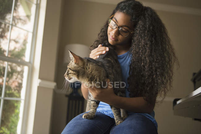 Girl with cat on lap — Stock Photo