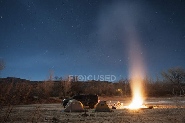 Campfire in rural landscape — Stock Photo