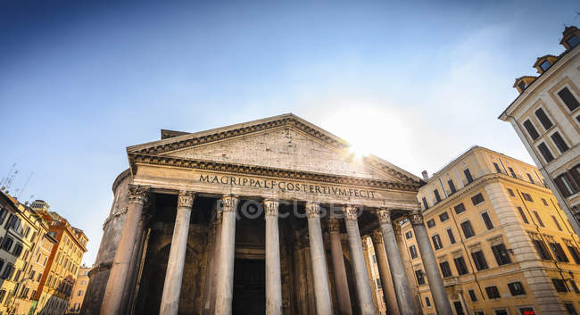 Classical temple among modern buildings — Stock Photo