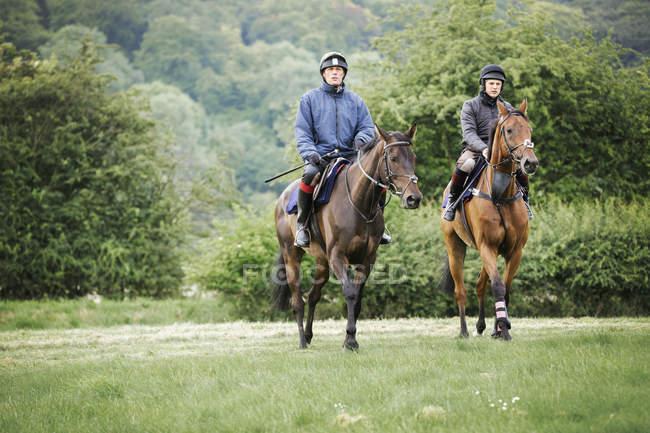Two men on horses — Stock Photo