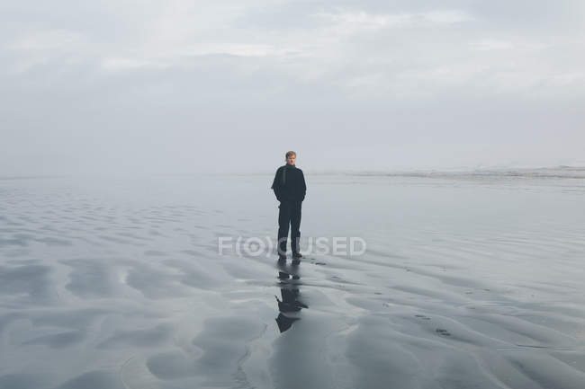Man standing on beach at Seabrook — Stock Photo